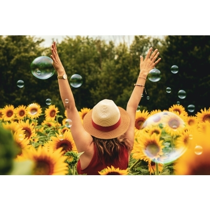 photography-of-woman-surrounded-by-sunflowers-1263986.jpg